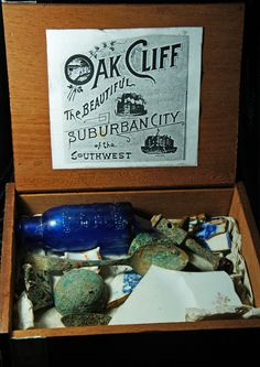 Oak Cliff Dump Box #1  open showing lid and contents containing artifacts dating from the 1890's recovered by Alexander M. Troup during the 1990's. Photography by Scott Dorn.