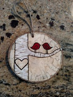Custom made wood burned birch tree ornament. Send me the initials you would like in the heart and I will make your personalized ornament. Finished product will look similar to picture but not identical due to natural variations in wood. See last photo for an idea of the variety if wood slices I work with. A date can be added under the branch at no additional cost. The year (2016) or a 6 digit date (12-29-14) are options. Color of the love birds can be customized upon request - please add a…