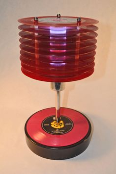 Red vinyl decorative mood lamp made from Punk-Rock 45's.. $250.00, via Etsy.