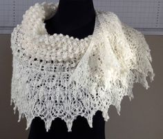 A personal favourite from my Etsy shop https://www.etsy.com/au/listing/515360015/cream-lace-knit-shawl-australian-merino