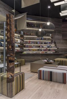 Kuoni Newcastle - design by Dreimeta. :::wood, shelving, decor, quirky, eclectic, travel, design, lounge, fabrics