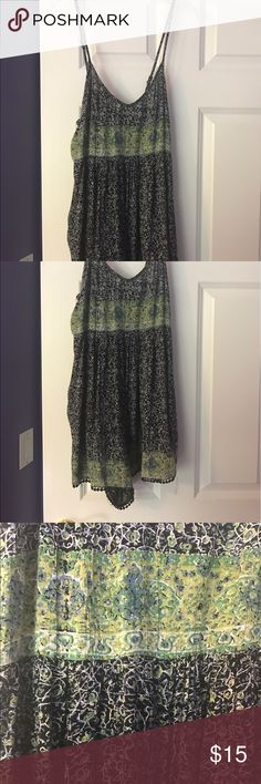 Forever21 black/navy blue/green floral romper Navy blue and blackbfloral romper with green floral design band near waist.. from Forever21 Contemporary line.. adjustable straps.. worn only one time in excellent condition... size small... black threaded detail on bottom of romper Forever 21 Other