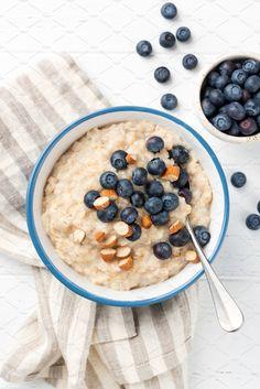 Bowl of healthy oatmeal porridge with blueberries and almonds by Vladislav Nosick / Porridge Recipes, Oatmeal Recipes, High Carb Snacks, Granola, Oatmeal Porridge, Eat Fat, Aesthetic Food, No Cook Meals, Food Inspiration