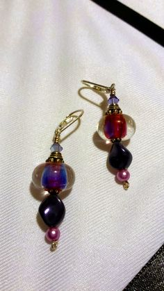 Check out this item in my Etsy shop https://www.etsy.com/listing/208734472/purple-passion-lampwork-and-pearl-dangle