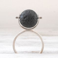 """The ring is simple yet elegant! The designer turns a lava ball into a piece of art creation that I can wear everyday! The artist/owner of the shop provides proactively very professional/customizable recommendations for her returning customer when she ""sees"" it can be done better!"" chinathalieyuan #etsy #black #women #round #silver #minimalist #anniversary #blacklavaring #geometricring #sterlingsilverring"