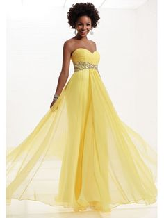 Long yellow dress with jeweled belt. Make it blue and we've got ourselves a bridesmaids dress!
