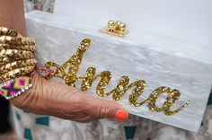 Anna Dello Russo's fabulous clutch. Details in street style  This was made for me lol! :)