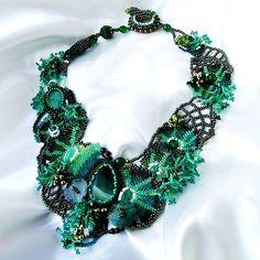 Free form beaded jewelry by Ibolya Barkoczi - I especially love the webbing on the right!