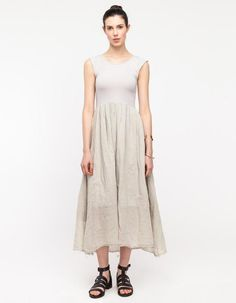 Simple and subdued tank dress with pleated skirt from Black Crane. Features a lightweight cotton ...