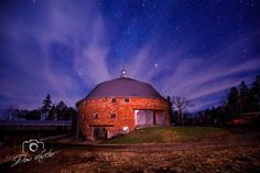 Plagmann Round Barn, Marengo, Iowa // 85' diameter, 3 story barn built in 1912 of clay tile considered the largest round barn in Iowa. The first story was for cattle, second story had 30 horse stalls, and the 110,000 cubic ft 3rd story loft held 200 tons of hay. central silo is 20' diameter and 45' tall (60 feet to top of barn). Second Story, First Story, Clay Tiles, Horse Stalls, Iowa, Northern Lights, Barn, Horses, Cattle
