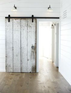 DIY barn door can be your best option when considering cheap materials for setting up a sliding barn door. DIY barn door requires a DIY barn door hardware and a Barn Renovation, House Design, Door Design, Barn Door Designs, House Styles, Modern Farmhouse, Trending Decor, Sliding Doors, Doors