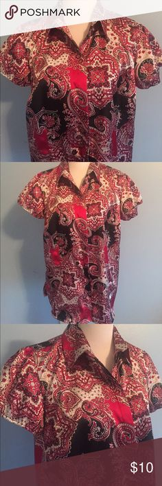 Red & Black Paisley Print Blouse Short-sleeved paisley print blouse in red and black. Elastic at sleeves. Button down. Bust is approximately 20 inches flat and length is approximately 28 inches from shoulder to hem. Made of poly/spandex. Size is 14/16W. Cato Tops Button Down Shirts