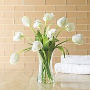 """White Tulip Bouquet The epitome of elegance year-round. Crafted with the look and feel of real blossoms, faux tulips are gracefully arranged in a simple glass vase with water illusion and will last indefinitely. 18""""High Imported"""