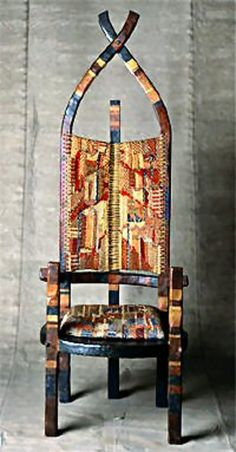 """""""African Chair""""  Oak and cherrywood  Painted in blue, different reds, yellow, gold;  adapted to the colour scheme of the fabric  Warp: strongly twisted hemp  Weft: hemp, wool, cotton. silk   1921  179.4 x 65 x 67.1 (HxWxD)    Bauhaus-Archiv, Berlin"""