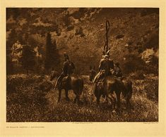 "In Black Cañon - Apsaroke, 1908. Caption: ""Although not exclusively mountain dwellers, they were ever fond of the hills, preferring the forest shade and the clear mountain streams to the hot ill-watered, monotonous prairies. The picture illustrates the Apsaroke custom of wearing at the back of the head a band from which fall numerous strands of false hair ornamented at regular intervals with pellets of bright-colored gum. Black Cañon is in the northern portion of the Bighorn mountains…"