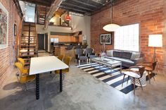 Eclectic living room with brick walls and concrete floors