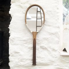 Unique tennis racket mirror, made with vintage tennis rackets!These mirrors look striking in bathrooms and hallways!Designs vary slightly. Each measures approximately wide x long.As featured in House and Garden Magazine October