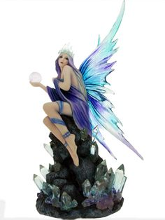 Stargazer Fairy by Nemesis Now from Absolute Angels Stargazer is a beautiful fairy dressed in blue who sits upon a crystal encrusted rock formation