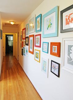 Group art and photos in colored frames on wall between kitchen and master, or within master bedroom. Make items differ from other photo wall in hallway.