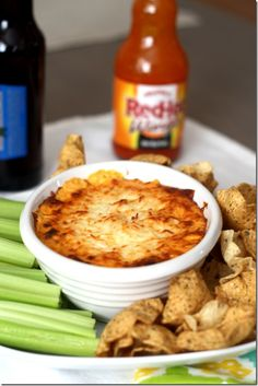 Greek Yogurt Buffalo chicken dip: 8 oz low fat cream cheese, 1/2 cup greek yogurt (YUM!), 1 tsp ranch (homemade or bought), 1/2 cup each hot sauce, blue cheese, and mozzarella, and 2-3 chicken tenderloins, poached and shredded, bake at 350 for 20 minutes.