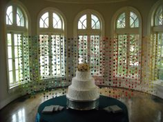 Over 1000 paper cranes like the ones in this curtain decorated the entire reception. Each one was handmade by the bride!