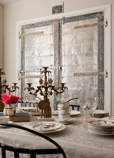 Suzie: Jenny Wolf Interiors - Eclectic dining room with tan walls paint color, silver doors . I could see me in here, just because of the doors! Nothing I love more than using doors as decor and especially when they incorporate SILVER. Tan Walls, Silver Walls, Interior Design Portfolios, Cool Doors, Wall Paint Colors, Dining Room Inspiration, Design Inspiration, Dining Room Design, Dining Rooms