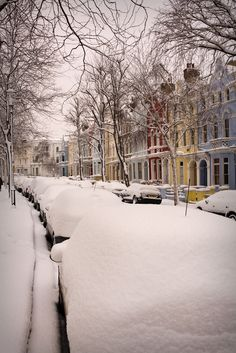Notting Hill, London; Pastel Coloured Houses And Snow Covered Cars