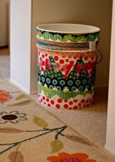 Mod Podged Fabric on a Paint Bucket now becomes whimsical trash can. http://todayscreativeblog.net/what-to-decoupage/