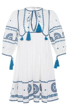This **Talitha** Embroidered Indian Peasant Dress features allover embroidery, puffed elbow length sleeves, tassels throughout, and a wide embroidered panel at the hem.