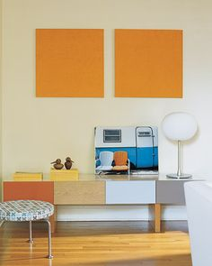 Living Room Details  Tosca ties everything together -- from kitchen to living roomto bedroom -- with a discerning use of color: In the living room, a pair of orange-chenille wall hangings pick up the same bright shade that is used in the kitchen.