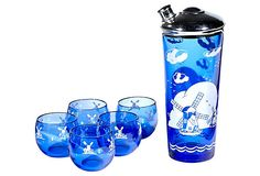 """Art Deco cobalt glass cocktail set with a white windmill scene. Five tumblers, 2.75""""Dia x 2.25""""H. Shaker Size: 4"""" W x 9.25"""" H"""