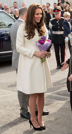 Downton Duchess from Kate Middleton's Mommy Style  En route to a set visit at Downtown Abbey, the pregnant Duchess captivates in a crisp Jojo Mamen Bebe maternity coat.