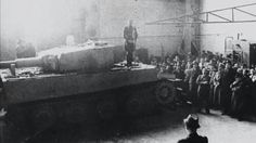 Obersturmführer Michael Wittmann uses a brand new Tiger I as a stage to give a speech to workers at the Henschel factory in Kassel, Germany. April 16, 1944