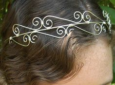 Its difficult to select a title for this item, because it can be several things: An elegant tiara that sits on your forehead, a crown that rests on the top of your head, or a head band. I created this pattern... Its sweet, elegant, beautiful, and it shines so well! I was very surprised