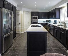 Shaker Style Doors, Recycling Center, Studio Kitchen, Black Stains, Corian, Kitchen Cabinetry, Quartz Countertops, Star Designs, Counter Top