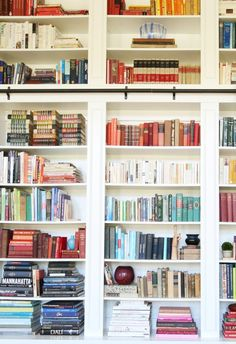 I will never not love the way Jenny styles her bookcases- efficiently so that you know where things should be, but beautifully as well!