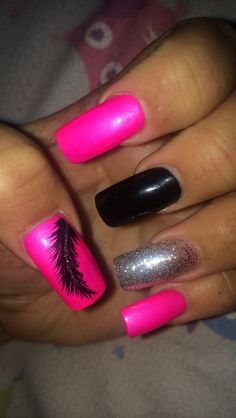 Acrylic nails. feather with glitter design. pink, black, and silver. bright summer color
