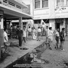 Members of the Chinese Red Cross in Surabaya (Soerabaja) remain ready to collect any casualties from the fighting. Album The Battle of Surabaya, November Independence War, Dutch East Indies, Street Fights, Red Cross, Surabaya, Holland, Battle, British, Street View
