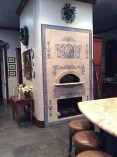 Wood burning oven with hand painted tiles.