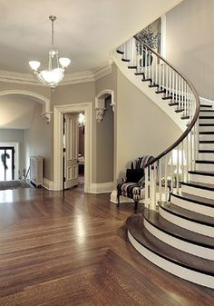 Beautiful. Love the gray walls, white trim, and wood floors. The arches and stair case are pretty easy on the eyes as well.