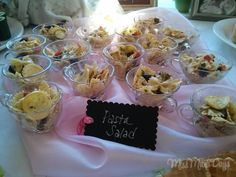Pasta Salad served in vintage glass cups! http://www.missmaesdays.com/baby-shower-on-a-budget/