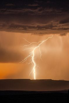 Lightning striking down over Canyonlands, Utah.