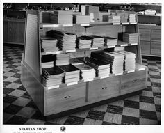 Image of a variety of notebooks on display at the San Jose State College Spartan Shop. Creator/Contributor: Del Carlo, Arnold Date: circa 1956 Contributing Institution: Sourisseau Academy for State and Local History
