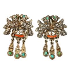 Earrings    Matilde Eugenia Poulat. 'Baby Quetzal Birds'.  Repousse silver, inlay turquoise and coral. c. 1930s, Mexico
