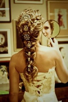 Love the use of mismatched clips on this long braid
