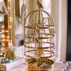 HARRY POTTER™ HEDWIG™ Jewelry Cage. Guard your treasures in gilded glamour! Inspired by Hedwig's™ very own iconic cage, this ornate jewelry holder boasts true, wizarding flair. Plus, your most valuable trinkets will be safe from goblins, CRABBE™ and GOYLE™.