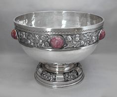 This is not contemporary - image from a gallery of vintage and/or antique objects. EDITH LINNEL An Arts & Crafts, stone set, silver bowl, with fruiting branch decoration.