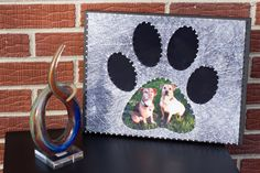 Your cat/dog(s) in a paw print string art