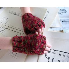 fingerless gloves: variegated red, knitted in acrylic wool via Polyvore