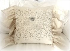 Ruffle Pillow - 42.00  ~ This is a handmade muslin pillow  with a 6 inch ruffle ~  It is embellished with a vintage  hand crochet doily and a vintage  brooch ~  It measures16 x 16 inches  not including the ruffle ~  The back has an invisible zipper   so the pillow form is removable ~  ~ Spot clean only ~ http://www.katiesrosecottagedesigns.com